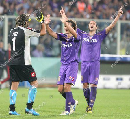 Fiorentina's goalkeeper Sebastien Frey with teammates, Gianluca Comotto and Alessandro Gamberini celebrating the victory
