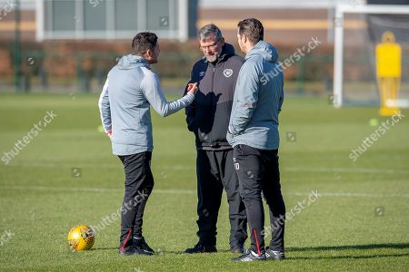 Craig Levein, manager of Heart of Midlothian chats with first team coaches Liam Fox (left) and Jon Daly (right) during the Heart of Midlothian training session ahead of the match against Motherwell, at Oriam Sports Performance Centre, Edinburgh