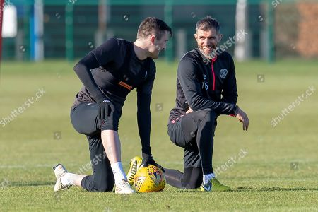 Aaron Hughes (#16) of Heart of Midlothian (right) jokes with John Souttar (#4) during the Heart of Midlothian training session ahead of the match against Motherwell, at Oriam Sports Performance Centre, Edinburgh