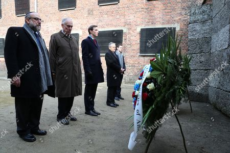 Stock Photo of (L-R) Chief Rabbi of Poland Michael Schudrich, president of the World Jewish Congress Ronald Lauder and White House Senior Advisor Jared Kushner at the Death Wall during their visit the former Nazi-German death camp of Auschwitz, in Oswiecim, southern Poland, 15 February 2019.