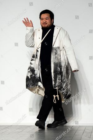 British designer A Sai Ta waves on the catwalk after presenting his collection for his label Asai during London Fashion Week 2019, in Central London, Britain, 15 February 2019. The LFW Fall/Winter 2019 runs from 15 to 19 February.