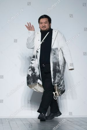 A Sai Ta acknowledges applause after his Autumn/Winter 2019 fashion week runway show in London