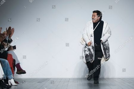 Stock Picture of A Sai Ta acknowledges applause after his Autumn/Winter 2019 fashion week runway show in London