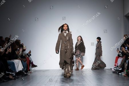 Stock Photo of A Sai Ta acknowledges applause after his Autumn/Winter 2019 fashion week runway show in London
