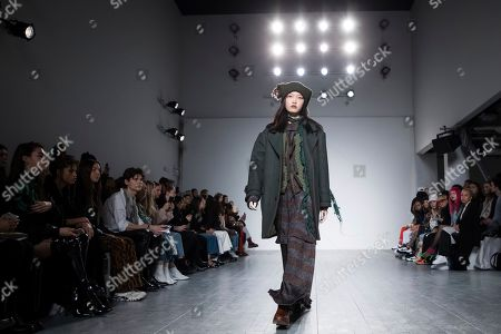 Stock Image of A Sai Ta acknowledges applause after his Autumn/Winter 2019 fashion week runway show in London