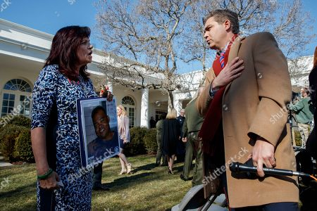 Sabine Durden, whose son Dominic was murdered by an undocumented immigrant, talks with CNN journalist Jim Acosta after an event with President Donald Trump at the White House declaring a national emergency in order to build a wall along the southern border, in Washington