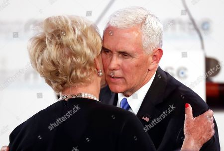 United States Vice President Mike Pence hugs Cindy McCain, widow of US Senator John McCain, after delivering his speech during the John McCain Dissertation Award Ceremony at the Bavarian State Parliament in Munich, Germany, . Pence arrived Thursday to attend the Munich Security Conference