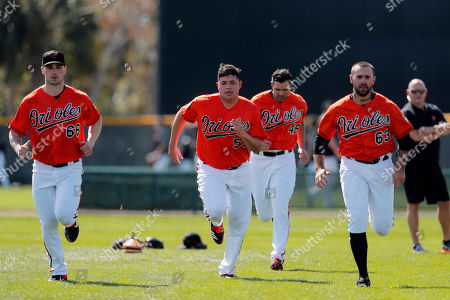 Baltimore Orioles relief pitchers Tanner Scott (66), Luis Ortiz, Richard Bleier (48) and Sean Gilmartin (63) work out at their spring training baseball facility in Sarasota, Fla