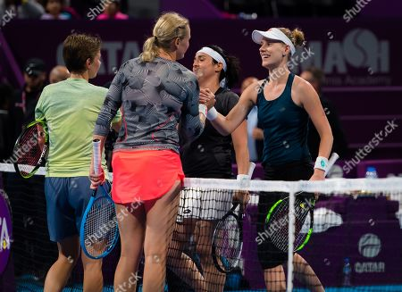Demi Schuurs of the Netherlands, Anna Lena Groenefeld of Germany, Ons Jabeur of Tunisia & Alison Riske of the United States in action during their doubles semi-final at the 2019 Qatar Total Open WTA Premier tennis tournament