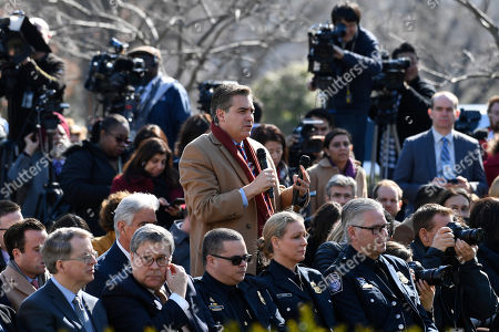 Jim Acosta of CNN asks President Donald Trump a question during an event in the Rose Garden at the White House in Washington, . Trump declared a national emergency in order to build a wall along the southern border