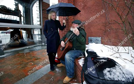 Kirsten Gillibrand, Kevin Clark. Sen. Kirsten Gillibrand, D-NY, sings along with street musician Kevin Clark, who plays a Cat Stevens' song, while touring Main Street in Concord, N.H., . Gillibrand visited New Hampshire as she explores a 2020 run for president. Clark said he's performed on the street since 2011