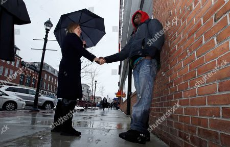 Kirsten Gillibrand, Eric Tembas. US Sen. Kirsten Gillibrand, D-NY, shakes hands with Eric Tembas, originally from Somalia, while touring Main Street in Concord, N.H., . Gillibrand visited New Hampshire as she explores a 2020 run for president