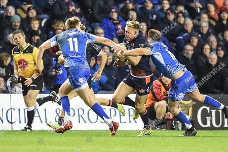 Stock Picture of Dougie Fife under pressure during the Guinness Pro 14 2018_19 match between Edinburgh Rugby and Dragons Rugby at Murrayfield Stadium, Edinburgh