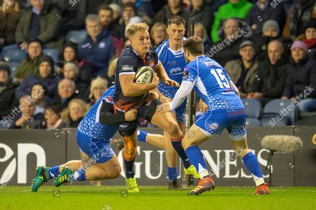 Duhan van der Merwe (#11) of Edinburgh Rugby is tackled by Richard Hibbard (#2) and Jordan Williams (#15) of Dragons Rugby during the Guinness Pro 14 2018_19 match between Edinburgh Rugby and Dragons Rugby at BT Murrayfield Stadium, Edinburgh