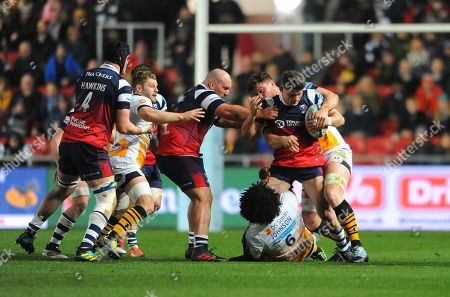 Piers OÕConor of Bristol Bears is tackled by Ashley Johnson of Wasps