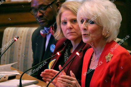 Stock Image of Retired radio talk show host Diane Rehm testifies in favor of a measure in Maryland that would allow the terminally ill to end their lives with the help of a doctor during a hearing, in Annapolis, Md. At center is Kim Callinan, CEO of Compassion & Choices, which supports the bill. The Rev. Charles McNeill, of Unity Baptist Church, left, also testified in favor of the bill