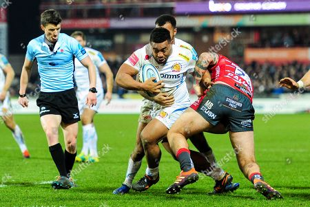 Elvis Taione of Exeter Chiefs is tackled by Matt Banahan of Gloucester Rugby