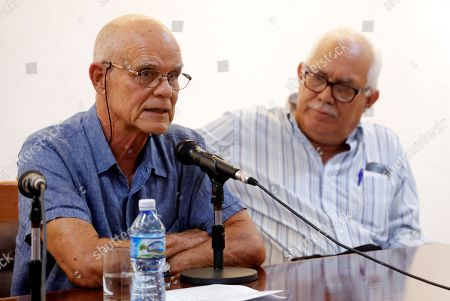 Stock Picture of Cuban writer Pedro Juan Gutierrez (L) speaks during the presentation of his book 'Dirty trilogy of Havana', in Havana, Cuba, 15 February 2019. Two decades after its publication in Spain the book has arrived in Cuba.