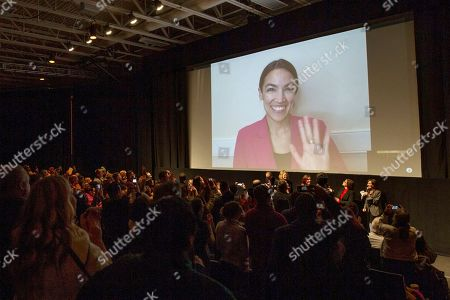 "Stock Picture of Alexandria Ocasio-Cortez, Rachel Lears, Paula Jean Swearengin, Amy Vilela, Cori Bush. Rep. Alexandria Ocasio-Cortez, D-N.Y. waves as she appears on screen via video conference for a question and answer session after the premiere screening of the documentary ""Knock Down the House"" during the 2019 Sundance Film Festival in Park City, Utah. On Friday, Feb. 15, 2018, The Associated Press has found that stories circulating on the internet that the congresswoman received $10 million for the documentary, are untrue"