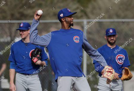 Chicago Cubs' Carl Edwards Jr. throws during a spring training baseball workout, in Mesa, Ariz