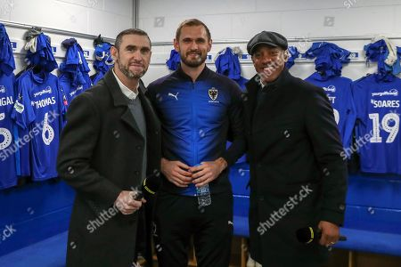 AFC Wimbledon striker James Hanson (18) with Martin Keown and Dion Dublin during the The FA Cup 5th round match between AFC Wimbledon and Millwall at the Cherry Red Records Stadium, Kingston