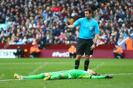 Match referee James Linington calls for the Villa physio as Aston Villa goalkeeper Lovre Kalinic (28) is injured during the EFL Sky Bet Championship match between Aston Villa and West Bromwich Albion at Villa Park, Birmingham