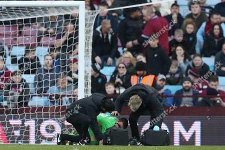 Aston Villa goalkeeper Lovre Kalinic receives treatment at half time
