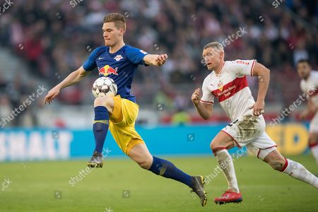 Leipzig's Marcel Halstenberg (L) in action against Stuttgart's Andreas Beck during the German Bundesliga soccer match between VfB Stuttgart and RB Leipzig in Stuttgart, Germany, 16 February 2019. CONDITIONS - ATTENTION: The DFL regulations prohibit any use of photographs as image sequences and/or quasi-video.
