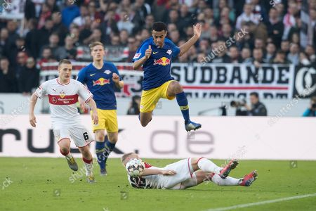 Leipzig's Tyler Adams (top) jumps over Stuttgart's Andreas Beck (bottom) during the German Bundesliga soccer match between VfB Stuttgart and RB Leipzig in Stuttgart, Germany, 16 February 2019.