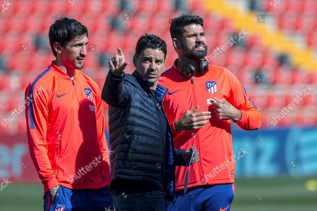 Atletico Madrid players Stefan Savic (L) and Diego Costa (R) chat with Rayo Vallecano's head coach, Miguel Angel Sanchez Munon (C), before the Spanish La Liga match between Rayo Vallecano and Atletico Madrid at Vallecas Stadium in Madrid, Spain, 16 February 2019.