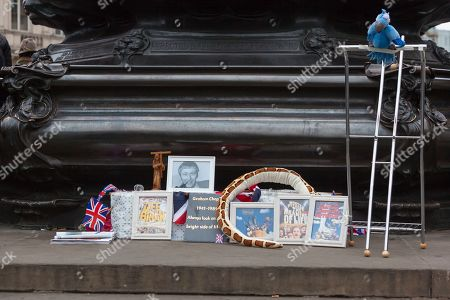 Stock Photo of Tributes to Graham Chapman at the Eros statue in Piccadilly Circus