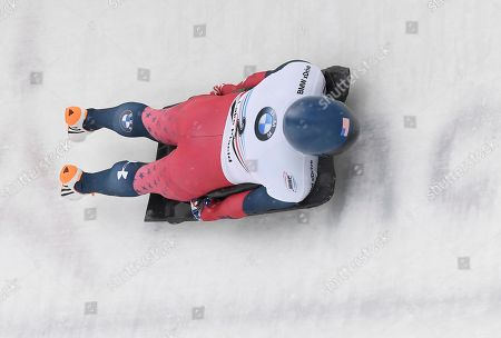 Stock Image of Greg West, of the United States, rounds a curve during the men's Skeleton World Cup event, in Lake Placid, N.Y
