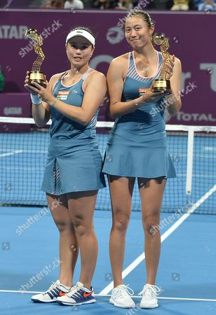 Hao-Ching Chan (R) and Latisha Chan (L) of Chinese Taipei pose with their trophies after winning the doubles final agents Demi Schuurs of Nederlands and Anna-Lena Groenefeld of Germany at the WTA Qatar Open tennis tournament in Doha, Qatar, 16 February 2019.