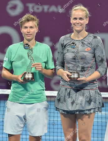Demi Schuurs (L) of the Netherlands and Anna-Lena Groenefeld (R) of Germany pose with their trophies after losing the doubles final at the WTA Qatar Open tennis tournament in Doha, Qatar, 16 February 2019.