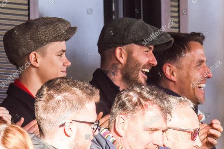 Romeo Beckham, David Beckham and Phil Neville celebrate Salford City scoring the first Goal of the match.
