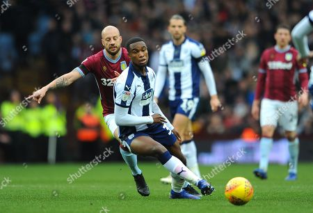 Alan Hutton of Aston Villa chases down Rekeem Harper of West Bromwich Albion- Mandatory by-line: Nizaam Jones/JMP