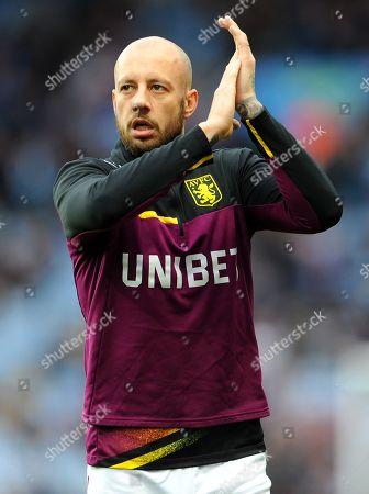 Alan Hutton of Aston Villa applauds fans