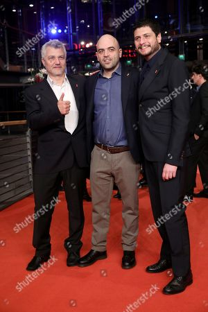 Maurizio Braucci (L), Roberto Saviano (C) and Claudio Giovannesi (R) arrive for the Closing and Awards Ceremony during the 69th annual Berlin Film Festival, in Berlin, Germany, 16 February 2019. The Berlinale that runs from 07 to 17 February.