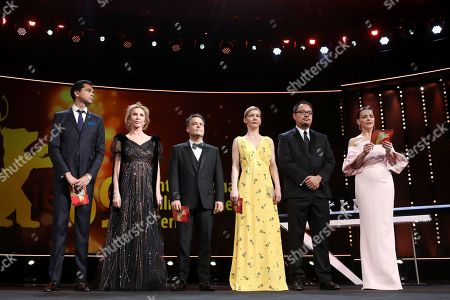 Members of the International Jury Rajendra Roy, Trudie Styler, Sebastián Lelio, Sandra Hueller, Justin Chang and Juliette Binoche during the Closing and Awards Ceremony during the 69th annual Berlin Film Festival, in Berlin, Germany, 16 February 2019. The Berlinale that runs from 07 to 17 February.