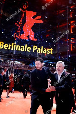 Claudio Giovannesi (L) and Roberto Saviano pose with the Silver Bear for Best Screenplay for 'La paranza dei bambini' (Piranhas) at the closing and award ceremony of the 69th annual Berlin International Film Festival, in Berlin, Germany, 16 February 2019. The Berlinale runs from 07 to 17 February.