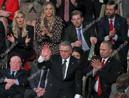 Tom Wibberley, lower center, the father of Navy Seaman Craig Wibberley, a Seaman killed on the USS Cole in Yemen, acknowledges the audience's applause after being introduced by United States President Donald J. Trump during his second annual State of the Union Address to a joint session of the US Congress in the US Capitol in Washington, DC. At lower left is Judah Samet and at lower right is Elvin Hernandez. Pictured behind Mr. Hernandez, from left to right, are: First Daughter and Advisor to the President Ivanka Trump, Lara Yunaska Trump, Eric Trump and Donald J. Trump, Jr.