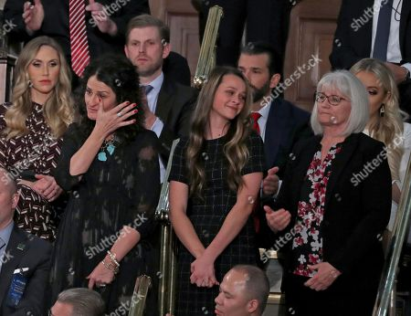 Heather Armstrong wipes away a tear as she and Madison Armstrong and Debra Bissell are introduced by United States President Donald J. Trump during his second annual State of the Union Address to a joint session of the US Congress in the US Capitol in Washington, DC. They represent three surviving generations of the family of Gerald and Sharon David of Reno, Nevada, who were murdered in their home by an illegal immigrant i. Pictured behind Ms. Armstrong are Lara Yunaska Trump, left and Eric Trump, right.