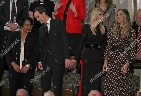 Senior Advisor Jared Kushner, second left, converses with Alice Johnson, left, who had been serving a mandatory life sentence without parole for charges associated with a nonviolent drug case, as he holds hands with his wife First Daughter and Advisor to the President Ivanka Trump, second left, who is in conversation with Lara Yunaska Trump, right, prior to United States President Donald J. Trump delivering his second annual State of the Union Address to a joint session of the US Congress in the US Capitol in Washington, DC. Kushner and actress Kim Kardashian West brought Johnson's case to the President who granted her clemency.