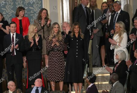 First lady Melania Trump waves as she arrives prior to United States President Donald J. Trump delivering his second annual State of the Union Address to a joint session of the US Congress in the US Capitol in Washington, DC. Pictured standing with the first lady, from left to right: Senior Advisor Jared Kushner, First Daughter and Advisor to the President Ivanka Trump, Lara Yunaska Trump, and Tiffany Trump.