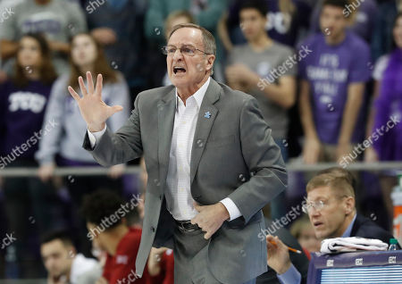 Stock Picture of Oklahoma head coach Lon Kruger yells from the sidelines during the first half of an NCAA college basketball game against TCU in Fort Worth, Texas