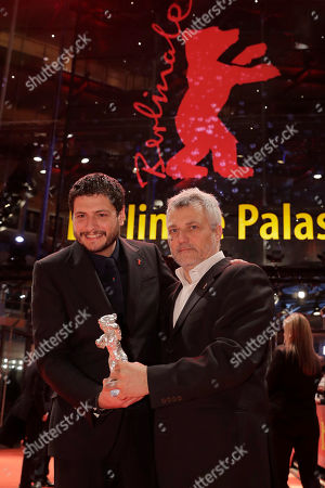 Claudio Giovannesi, Maurizio Braucci. Writers Maurizio Braucci, right, and Claudio Giovannesi hold the silver bear best screenplay award for the film 'Piranhas' after the award ceremony of the 2019 Berlinale Film Festival in Berlin, Germany
