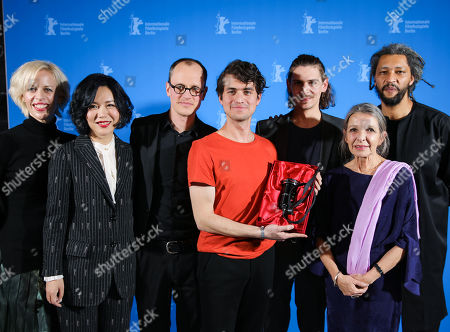 Mehmet Akif Buyukatalay (C), Bastian Kluegel (3rdR) and Claus Reichel (3rdL) winner of the GWFF First Feature Award for 'Oray' pose with Katja Eichinger , Vivian Qu and Alain Gomis at the closing ceremony of the 69th annual Berlin International Film Festival in Berlin, Germany, 16 February 2019. The Berlinale runs from 07 to 17 February.