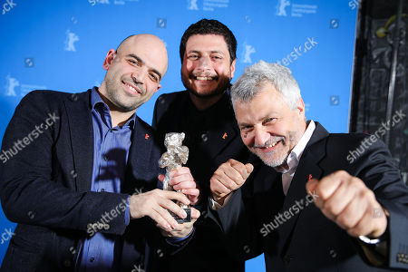 Roberto Saviano, Claudio Giovannesi and Maurizio Braucci, winner of the Silver Bear for Best Screenplay for 'Piranhas' pose at the closing ceremony of the 69th annual Berlin International Film Festival in Berlin, Germany, 16 February 2019. The Berlinale runs from 07 to 17 February.