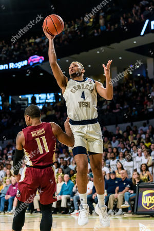 Georgia Tech guard Brandon Alston (4) shoots the ball over Florida State guard David Nichols (11) during the first half of an NCAA college basketball game, in Atlanta