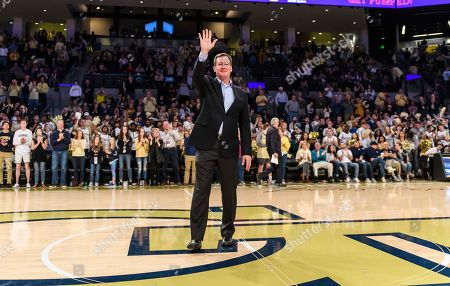 Stock Image of Former Georgia Tech player Mark Price is recognized during the first half of an NCAA college basketball game against Florida State, in Atlanta